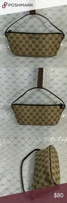 Authentic Gucci GG Pochette Monogram Satchel Csnvas and leather showed signs of used as the bag was preowned. The bag was made in Italy with a serial number 002058 0391103. The handle had some curling on one side. The measurement us 4.5, 10.5 and 3.5. Gucci Bags Clutches & Wristlets