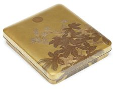 An Imperial presentation gold lacquer suzuribako and cover by Akatsuka Jitoku, 20th century,with rounded corners and an overhanging lid, decorated with a flowering yatsude, the design extending over the lid to two sides, the kikumon appearing prominently on the lid, containing en-suite fitted, movable trays for an ink-stone, a silvered-metal mizuire chased with trailing kiku, an ink-stick holder, a spike, a knife, and two brushes with nashiji holders and silver fittings