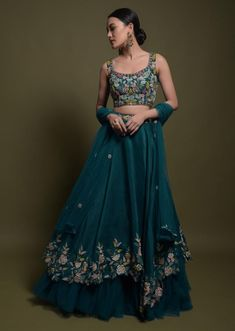 Teal Lehenga Choli In Cotton Silk With Fancy Cutout Hemline And Floral Embroidery Online - Kalki Fashion Best Picture For button up Blouse For Your Taste You are looking for something, and it is going Indian Bridal Fashion, Indian Fashion Dresses, Dress Indian Style, Indian Designer Outfits, Designer Dresses, Indian Reception Outfit, Indian Wedding Outfits, Indian Outfits, Indian Clothes