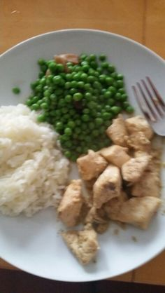 Royal chicken in yogurt with rice and peas yummy!
