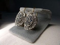 Pair of antique 14K rose gold diamond and sapphire earrings. Each elegant piece features 20 rose cut diamonds with a diameter of 2 mm each and 10 natural round