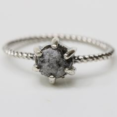 Rough diamond and sterling silver ring in prongs setting with oxidized sterling silver twist design band