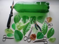 Recycled green plastic bottles cut or burned into leaf shapes – Artofit Reuse Plastic Bottles, Plastic Bottle Flowers, Plastic Bottle Crafts, Diy Bottle, Recycled Bottles, Recycled Crafts, Diy And Crafts, Arts And Crafts, Plastic Art
