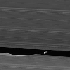 The wavemaker moon, Daphnis, is featured in this view, taken as NASA's Cassini spacecraft made one of its ring-grazing passes over the outer edges of Saturn's rings on Jan. 16, 2017. This is the closest view of the small moon obtained yet.