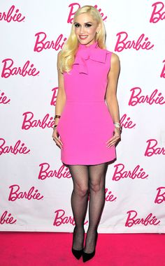 Pretty in Pink from Gwen Stefani's Best Looks In a bright pink dress with a necktie Gwen And Blake, Gwen Stefani And Blake, Gwen Stefani Style, Gwen Stephanie, Gwen Stefani No Doubt, Bright Pink Dresses, Gavin Rossdale, Blake Shelton, Le Jolie