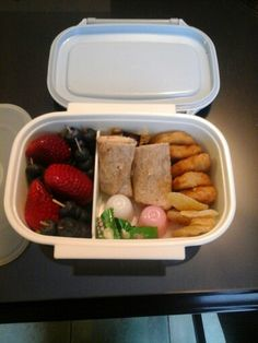 Fisrt Bento! -white meat chicken nuggets -small torrtilla wrap cut in half. Filled with spicy chicken deli meat and swiss cheese -sweet ginger - jelly puddings -guava candy -strawberries  -blueberries