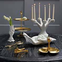 Serve Surrealism.Our sculpturally seductive hands are ready to serve you. In gleaming brass finished with food-safe lacquer, they give an edgy glamour to w