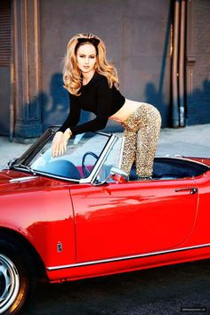 df9bba58c2744 Jennifer Lawrence by Ellen von Unwerth. Big voluminous waves with a black  bow, crop top   leopard pants on a classic red sports car. Retro and  gorgeous