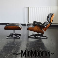 Eames Lounge Chair & Ottoman, produced by Herman Miller / Hille UK in 1960's Rosewood and down cushions with black leather