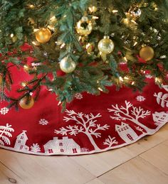 Surround your tree with Plow and Hearth's bright red Village Scene Tree Skirt, presented on red woolen felt embellished with embroidery. Tree Skirt features a quaint village scene with snow falling, a delightful setting for your holiday gifts.