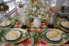 Summer Table Setting - Love the leaf chargers, the daisy flowers, and the corn on the cob at each setting. <3