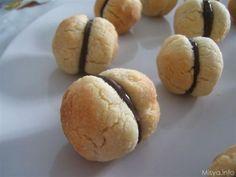 Baci di dama. Scopri la ricetta: http://www.misya.info/2007/07/12/baci-di-dama.htm