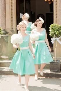 Short Tiffany Blue Bridesmaids Dresses with matching white fascinators from www.MyArtDeco.co