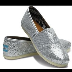 Silver Toms in Size 6.5 Brand new with tags! TOMS Shoes Flats & Loafers