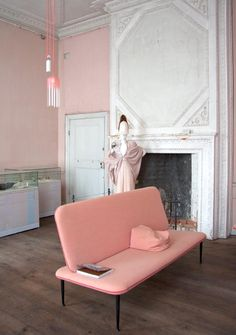 Pretty pink interiors with pink sofa and pink walls