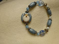 Sweet polymer clay owl bracelet with matching polymer clay beads.