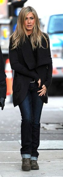 Jennifer Aniston's style is the bomb. Everyone knows it. dark denim jeans, black sweater wrap.