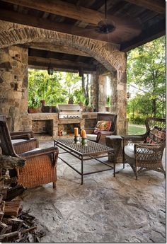 Covered patio; fireplace to photo left; native stone and post-and-beam construction
