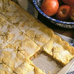 All-time favorite apple pastry recipe.      Delicious served with Rummy Sauce:  In a small saucepan, melt 1/2 cup butter. Stir in 1 cup sugar and 1/2 cup light cream. Bring just to boiling over medium heat. Reduce heat and cook for 3 minutes, stirring occasionally. Remove from heat. Stir in 2 tbsps. rum, 1 tsp. ground nutmeg and 1 tsp. vanilla. Drizzle over pastry squares.
