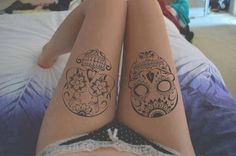 Outline sugar skull tattoos.