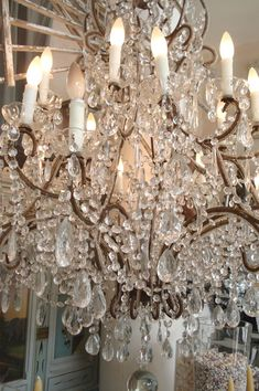 I have GOT to have a light fixture like this... maybe in a dressing room or closet?! dream big.