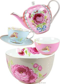Great colors in the teapot and the cups and saucers.  I might certainly drink more tea if I owned these.