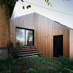 Built by CUT Architectures in Meudon, France with surface Images by David Foessel. The project is the extension and refurbishment of a very small detached house in Meudon, one of the nearest suburbs o. Studios Architecture, Space Architecture, Wooden Architecture, Cedar Cladding, Cedar Siding, Wooden Facade, Red Cedar Wood, Timber House, House Extensions