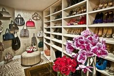 Closet in a home in Hidden Hills, CA designed by Sue Firestone - Love the hanging purses