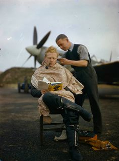 Books for Victory: Publishing During WWII: RAF pilot reading a book during haircut