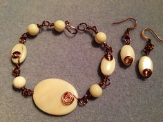 Antique copper wire wrapped bracelet & earrings with mother of pearl.  www.JulesLittleGems.com