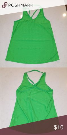 "Athleta neon green strappy tank Athleta neon green perforated strappy tank. 90% polyester, 10% spandex. One strap around the neck and an ""X"" shape straps in the back. Size XS. Good condition. Athleta Tops Tank Tops"