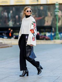 layering clothes: Tine Andrea in a black roll-neck and layered skirt