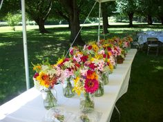 August wedding flower centerpieces with in season, farm fresh, flowers by yours truly! I love the natural, wildflower look they provide for this outdoor summer wedding.