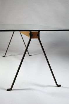 Glass top, beech beam and forged iron legs. H: 72 mc/ 28 1/2'' L: 275 cm/ 108 1/2'' D: 85 cm/ 33 1/2''