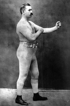 John L. Sullivan. Last Bare Knuckle Champ. First Gloved Champ (Under London Prize Ring Rules!). Undefeated for OVER TEN YEARS. Fought and Won the last bare knuckle match against Jake Kilrain on July 7th, 1889. Only loss after over a decade of Dominance, to a younger James 'Gentleman Jim' Corbett under queensberry rules. The Great John L. was the first American Sports Celebrity.  Has a series of memes inspired by him. One of my heroes.