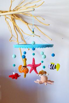 crochet baby mobile sea creatures bubbles smiles / by EvaSinai etsy Items similar to crochet baby mobile - sea creatures, bubbles, smiles / colorful crib mobile / nursery decor / kids room / shower gift on Etsy ideas for baby room Crochet Baby Mobiles, Crochet Mobile, Amigurumi Patterns, Crochet Patterns, Crochet Ideas, Free Crochet, Handgemachtes Baby, Baby Crib, Stuffed Toys Patterns