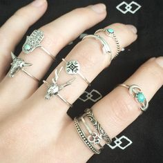 Summer always has her fingers covered in rings like this. (found on www.blackmoonshop.co.uk)