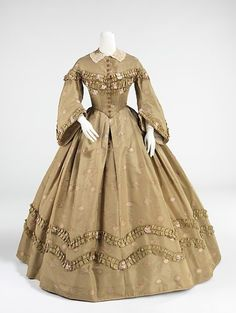 Silk Afternoon Dress | 1862 | Met Museum I'm purposefully skipping the 1850s because I'm not much of a fan, and what you see in the previous post from 1848 is pretty exemplary of 1850s styles as well. With the invention of the cage crinoline in 1858, skirts widened even more and lifted the weight and unwieldiness of the many petticoats previously used. The skirt silhouette in the height of the 1860s wasround.Skirt decorations were minimal compared to earlier periods, and bodices were…