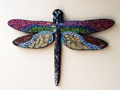Stained glass mosaic dragonfly wall hanging.