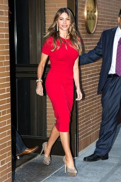 Sofia Vergara wearing a Michael Kors dress from our Transeason collection. September 2015