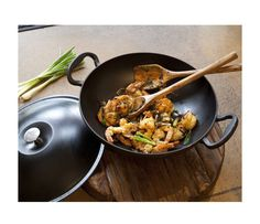 This enameled cast-iron wok is a home chef's dream, with the versatility to brown, braise, saute, sear, fry and boil.