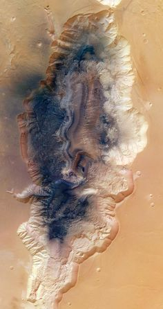 A tributary of the Grand Canyon of Mars, Hebes Chasma is pictured in this image taken by the European Space Agency's Mars Express orbiter on Oct. 10. Nearly 8 km deep, Hebes Chasma forms a giant trough of Valles Marineris, the largest canyon system in the solar system. Some 125 km across at its widest point, it's roughly 315 km long. Mars scientists believe that flowing water may have carved out the entire canyon system more than a billion years ago.