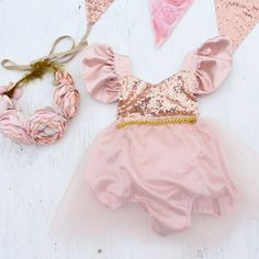 A must have for Spring birthdays or celebrations. Beautiful Full Tutu with sequin bodice and satin flutter sleeves. The sequin top is a halter. The neck ties help you adjust to the desired length. It