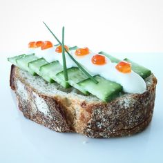 English cucumber, crème fraiche, chives, and fish roe on toasted sourdough batard. #toast