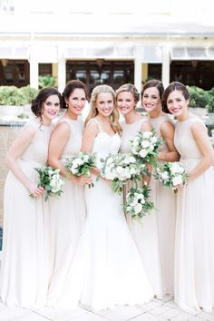 Beachy off-white bridesmaid gowns: http://www.stylemepretty.com/florida-weddings/bonita-springs/2016/05/09/why-an-all-white-wedding-is-never-going-out-of-style/ | Photography: Hunter Ryan Photo - http://hunterryanphoto.com/