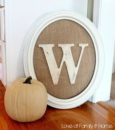 Grab an old frame, some burlap and an initial and voila, easy decor!   Front porch!!
