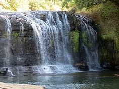 """The name """"Talofofo Falls Park"""" evokes imagery of an exotic tropical cascade, like something out of Jurassic Park. After leaving the main road along the eastern"""