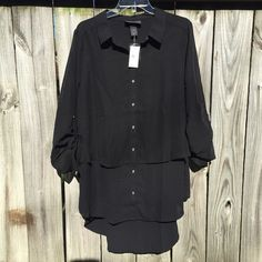 Black Tiered Blouse NWT NWT Silky black button-down blouse with tiered layers, longer in back, never worn! perfect condition Lane Bryant Tops Blouses