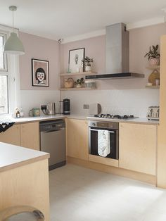 There is no question that designing a new kitchen layout for a large kitchen is much easier than for a small kitchen. A large kitchen provides a designer with adequate space to incorporate many convenient kitchen accessories such as wall ovens, raised. Kitchen Stove, New Kitchen, Kitchen Decor, Kitchen Styling, Kitchen Ideas, Devol Kitchens, Home Kitchens, Pink Kitchens, Small Kitchens