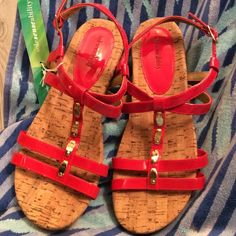 """Pretty orange cork sandals⭐️NWOT⭐️ Orange is great for this spring and summer according to Elle. Rubber sole. New never worn. Cork heal is one inch and gradual to toes of 1/2 """". Pretty gold accents. Right shoe left side os heal has blemish. See pic.  But really unnoticeable unless up close. Shoes Sandals"""